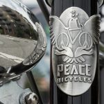 Peace Bicycles branded headbadge