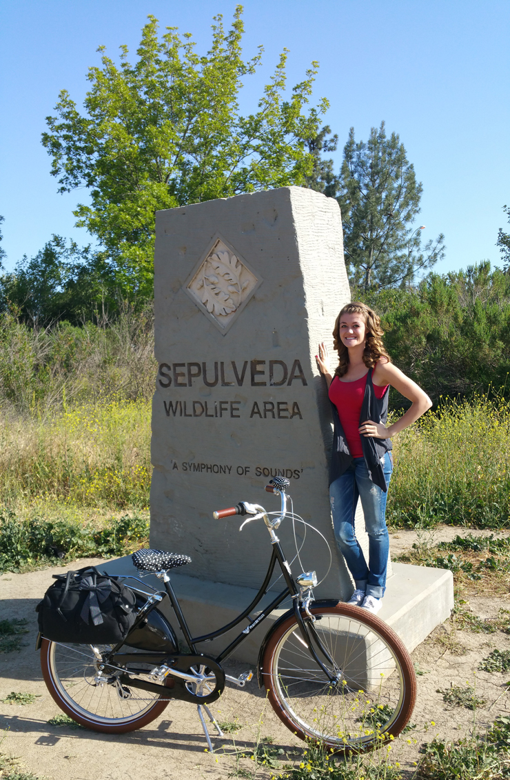 standing by sepulveda park entry stone