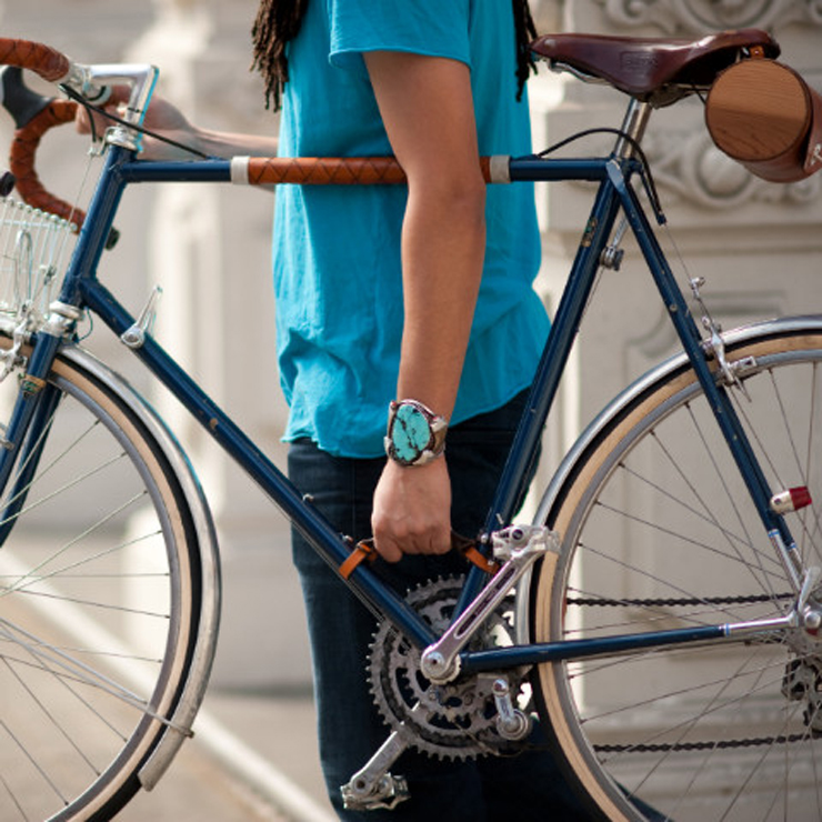 man holding bike by leather strap