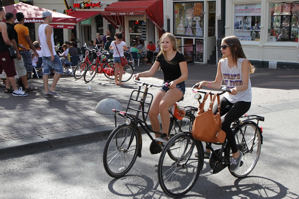 girls riding Amsterdam bikes