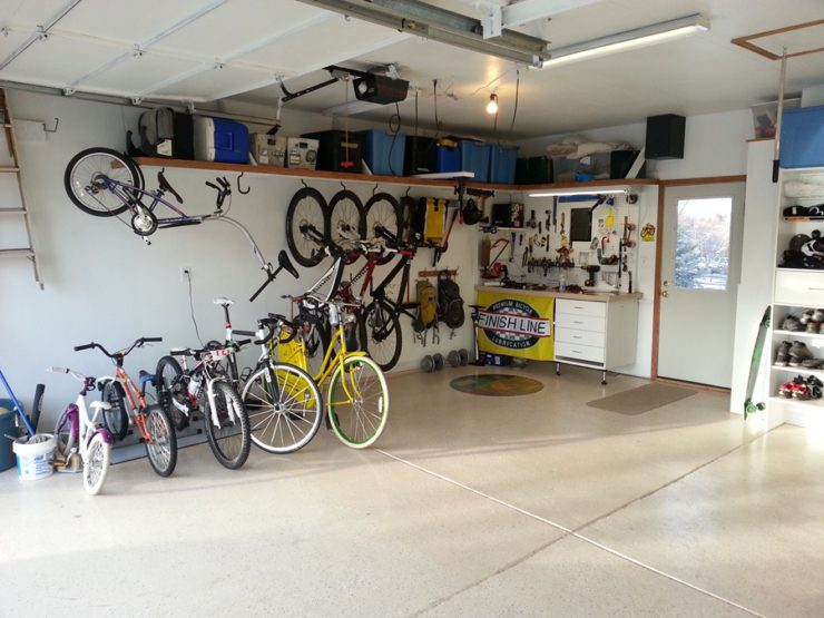 bikes parked neatly in a garage indicate a benefit of bicycling is added space