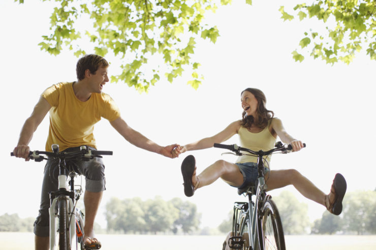 a couple shows the healthy bicycling benefits by being in great shape