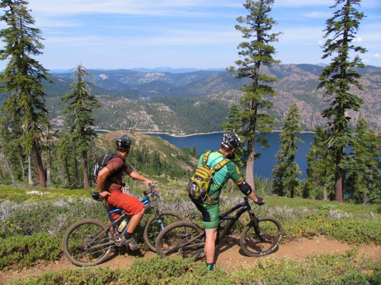 two riders in the mountains show a benefit of biking is the scenery
