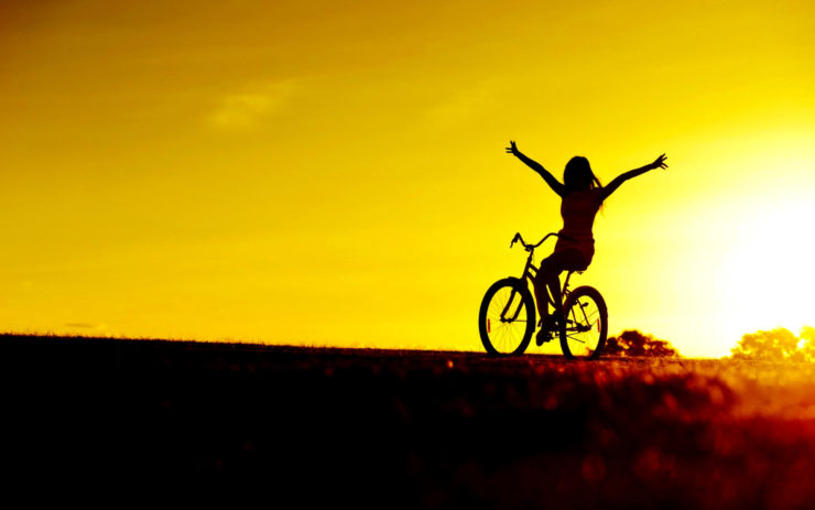 a rider enjoys freedom and improved self esteem as a health benefit of bicycling