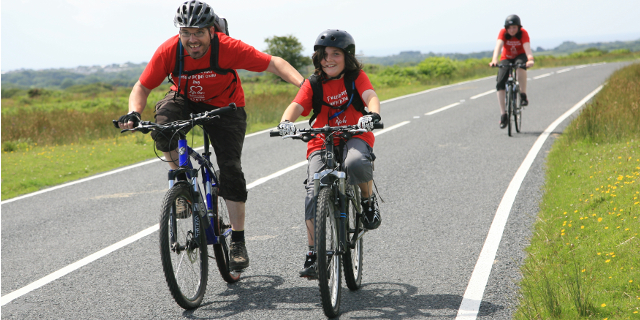 two riders do a charity bike ride as a benefit of biking