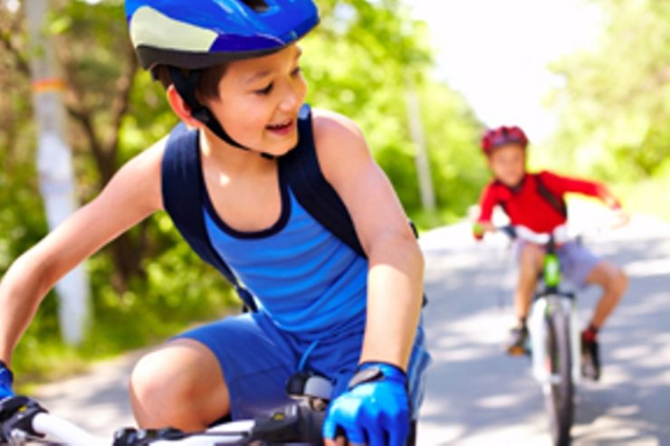 two kids enjoy the health benefit of bicycling that is staying young