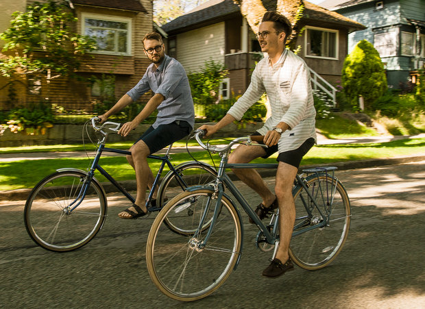 two casual riders enjoy bicycling health benefits on leisurely stroll