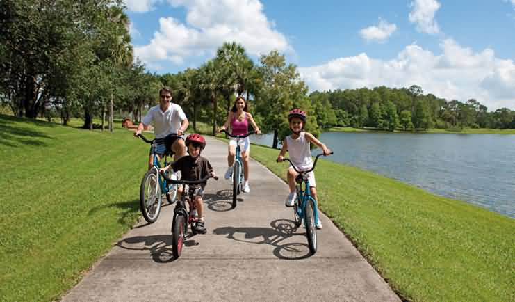 a family takes a ride together to reap the benefits of bicycle riding
