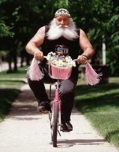 gruff man on pink bike proves a biking benefit is that it is non judgmental