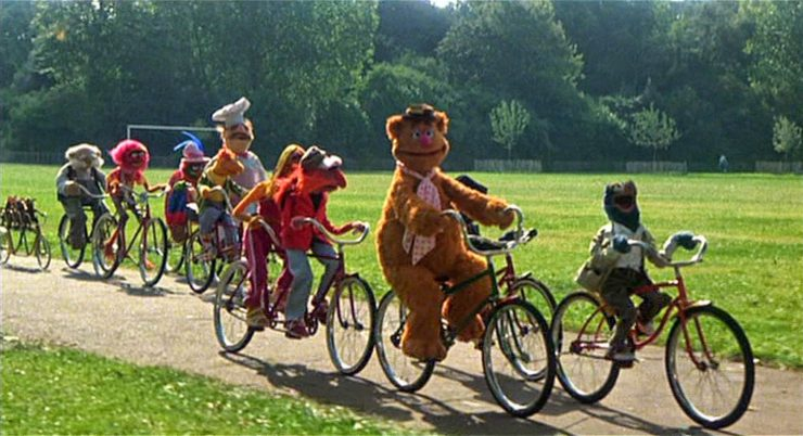 the muppets enjoy the benefits of bicycling in a group