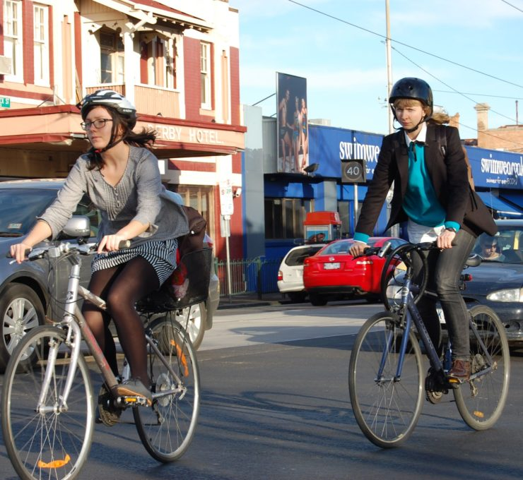 two riders enjoy healthy biking benefits as they commute to work