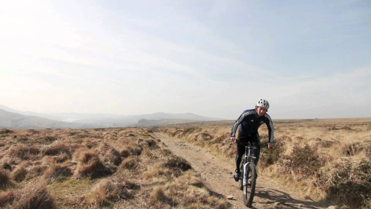 a rider enjoys the biking benefits of solitude pedaling alone in the desert