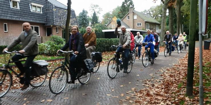 a group of older riders enjoy health benefits of bicycling and meeting new people