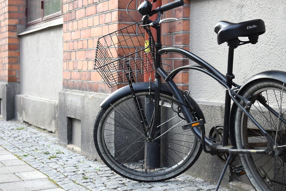 black beach cruiser bicycle with basket