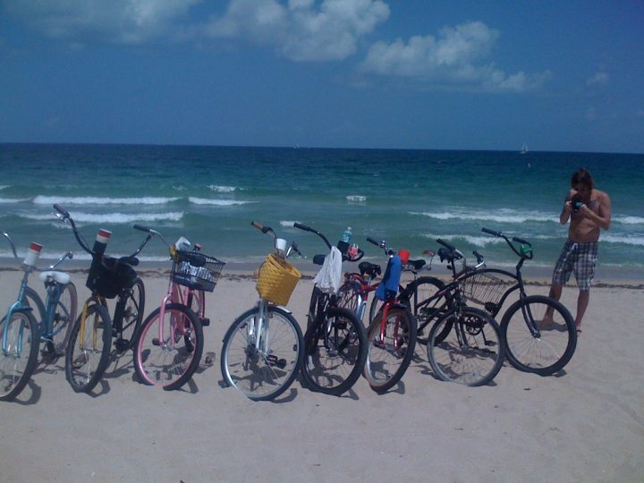 cruiser bikes in the sand by ocean