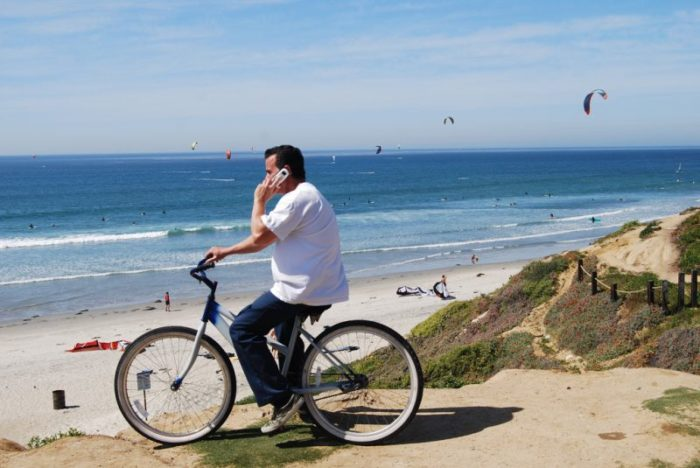 man on cheap beach cruiser