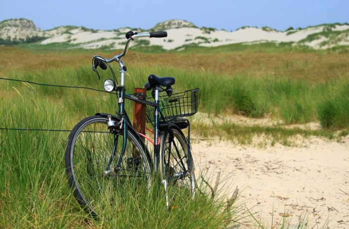 men's beach cruiser bike in sand