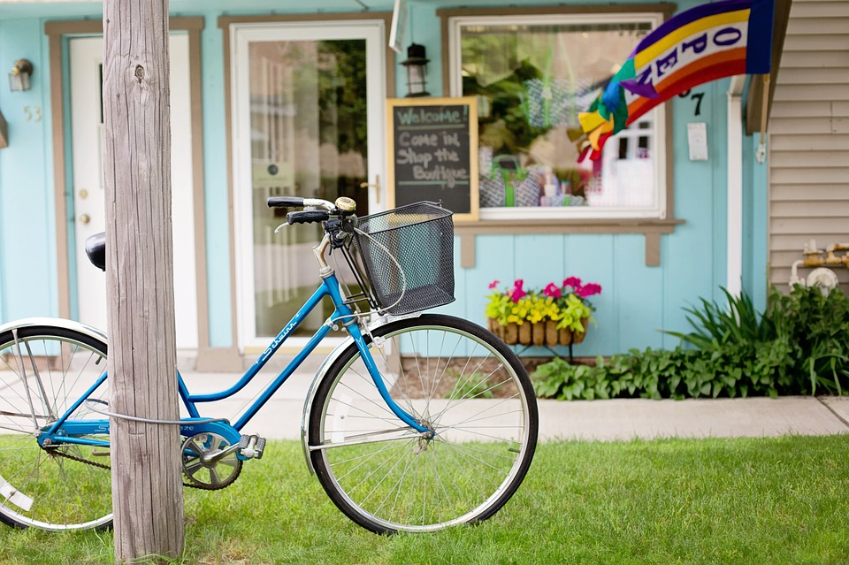 blue vintage beach cruiser with bell