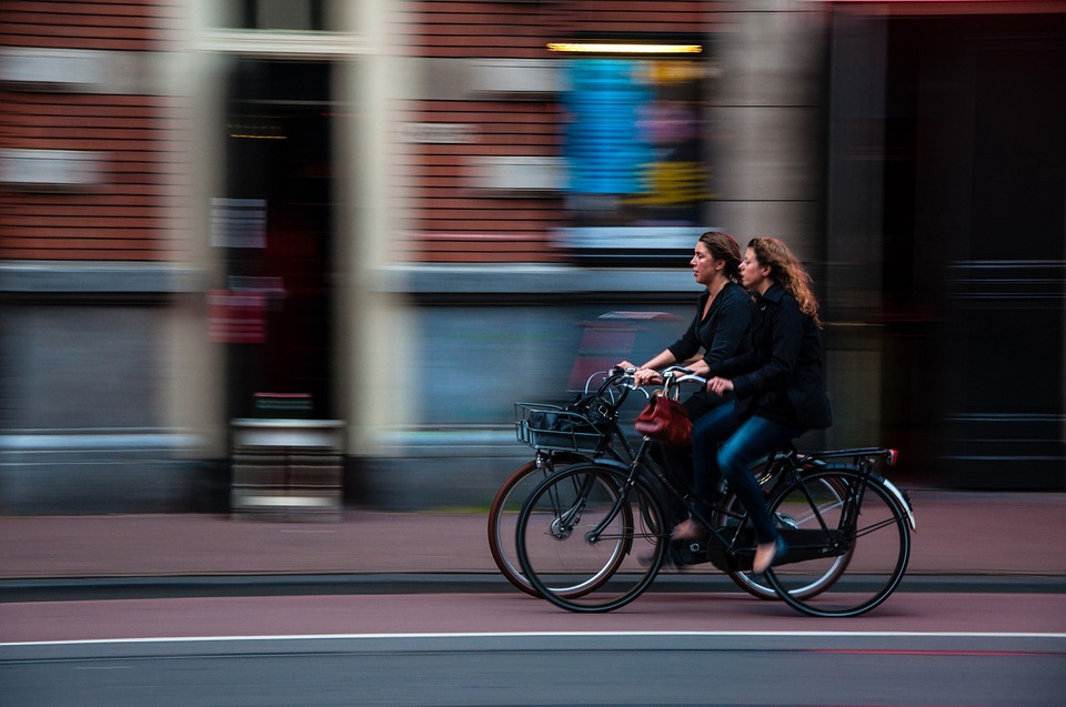 two women riding on Women's Cruiser Bikes