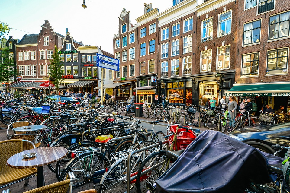 amsterdam bikes in a cafe square