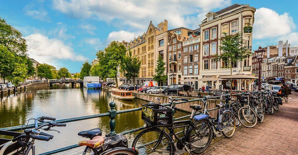 amsterdam bikes on a bridge